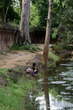 Cambodian children at a pond near  Banteay Srey temple Royalty Free Stock Photos