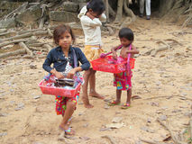 Cambodian children sell souvenirs Royalty Free Stock Photos
