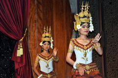 Cambodian dancers with the traditional costume. December 2012, Siem Reap, Angkor Wat area (Cambodia) - Khmer classical dancers with the traditional costume Royalty Free Stock Image
