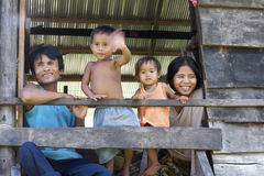 Cambodian Family. SIEM REAP, CAMBODIA- Oct 4: An unidentified Cambodian couple with their children look out from their home in Siem Reap, Cambodia on October 4 Stock Images