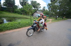 Cambodian family on a motorbike Stock Image