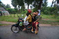 Cambodian family on a motorbike Stock Photos