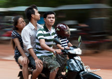 Cambodian family - 4 on a scooter Stock Images