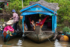 Cambodian family on wooden raft houseboat Royalty Free Stock Photos