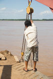 Cambodian Ferry Worker Royalty Free Stock Images
