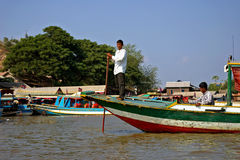 Cambodian fisherman on a boat Stock Photography