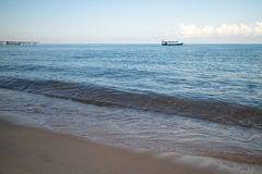 Small Boat on the Ocean near the Beach Stock Image