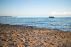 Small Boat on the Ocean near the Beach Stock Photo