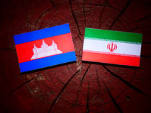 Cambodian flag with Iranian flag on a tree stump isolated. Cambodian flag with Iranian flag on a tree stump Stock Images