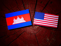 Cambodian flag with USA flag on a tree stump royalty free stock photography