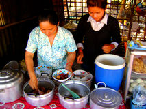 Cambodian food stand. Cambodian woman serving food at a stand stock images