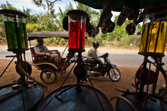 Cambodian gas station with colorful petrol display Stock Photography
