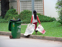 Cambodian girl cleans the street Royalty Free Stock Images