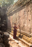 Cambodian Girl in Khmer Dress at Ancient Building of Angkor City Stock Photos
