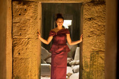 Cambodian Girl in Khmer Dress in Ancient Building of Angkor City Royalty Free Stock Photos