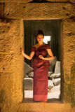 Cambodian Girl in Khmer Dress in Ancient Building of Angkor City Stock Images