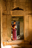 Cambodian Girl in Khmer Dress in Ancient Building of Angkor City Royalty Free Stock Images