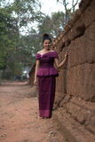 Cambodian Girl in Khmer Dress by the Ancient Wall of Phnom Bakheng, Angkor City Royalty Free Stock Images