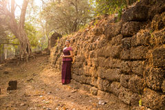 Asian Girl in Traditional Dress by an Ancient Stone Temple Wall in Angkor, Cambodia Stock Image