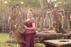 Cambodian Girl in Khmer Dress at Bayon Temple in Angkor City Royalty Free Stock Images