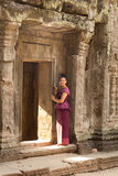Cambodian Girl in Khmer Dress by Doorway of  Ancient Building of Angkor City Stock Photos