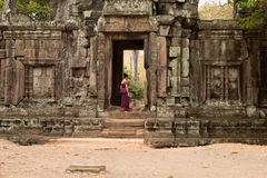Cambodian Asian Girl in Traditional Dress in the Doorway of an Ancient Temple Wall Royalty Free Stock Photos