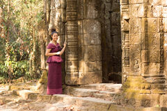 Cambodian Girl in Khmer Dress by Door to Ancient Building near Ta Prohm Stock Photography