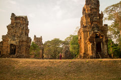 Cambodian Asian Girl by Temple Towers of Angkor Thom Royalty Free Stock Photo