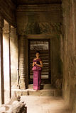 Cambodian Girl in Khmer Dress Standing in Bayon Temple in Angkor City Royalty Free Stock Images