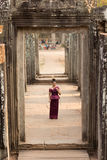 Cambodian Girl in Khmer Dress Standing in Bayon Temple in Angkor City Royalty Free Stock Photos