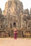 Cambodian Girl in Khmer Dress Standing at Bayon Temple in Angkor City Royalty Free Stock Images