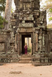 Cambodian Asian Girl in Traditional Dress Wai in the Doorway of an Ancient Temple Wall Royalty Free Stock Image