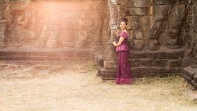 Cambodian Girl in Khmer Dress Standing at the Terrace of the Elephants in Angkor City Royalty Free Stock Photography