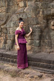 Cambodian Girl in Khmer Dress Standing at the Terrace of the Elephants in Angkor City Stock Images