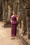 Cambodian Girl in Khmer Dress Standing at the Terrace of the Elephants in Angkor City Royalty Free Stock Photo
