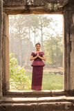 Cambodian Asian Girl in Traditional Dress in a Stone Doorway at Angkor Temple Stock Photography