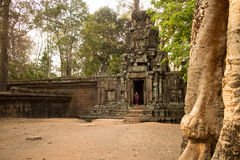 Cambodian Asian Girl in Traditional Dress in the Doorway of an Ancient Temple Wall Royalty Free Stock Photography