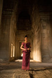Happy Smiling Asian Girl in Traditional Dress in the Halls of Angkor Wat Temple Stock Photos