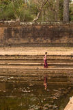 Cambodian Girl in Khmer Dress Stands by a Pool of Water in Angkor Thom Stock Photos