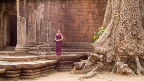 Cambodian Girl in Khmer Dress by Tree at Ancient Building of Angkor City Stock Images