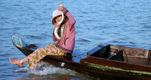Cambodian girl (with snake) on a boat Stock Photos