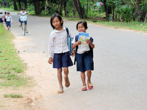 Cambodian girls going to school. Cambodian children girls with books going to school, People living in Cambodia. South east Asia Stock Photos