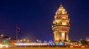 Independence Monument in Phnom Penh. The Cambodian Independence Monument and Phnom Penh skyline at night Royalty Free Stock Photo