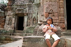 Cambodian Kid at Angkor Wat Royalty Free Stock Images