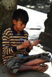 Cambodian Kid Studying in Angkor Wat Temple Royalty Free Stock Image