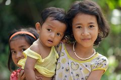 Cambodian kids. Cambodian little girl holding her younger sister,Siem Reap, Cambodia on December 04, 2012 Royalty Free Stock Photography