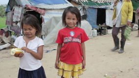 Cambodian kids in slums near phnom penh city dumping area stock video footage