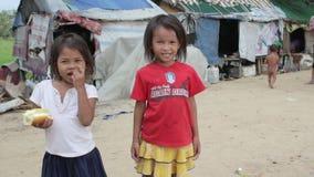 Cambodian kids in slums near phnom penh city dumping area stock video footage
