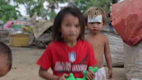 Cambodian kids in slums near phnom penh city dumping area Royalty Free Stock Photography