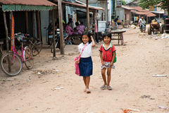 The Cambodian life. SUBURB SIHANOUKVILLE, CAMBODIA. FEBRUARY 26, 2013 - Two small Cambodian girls go home from school Stock Photos